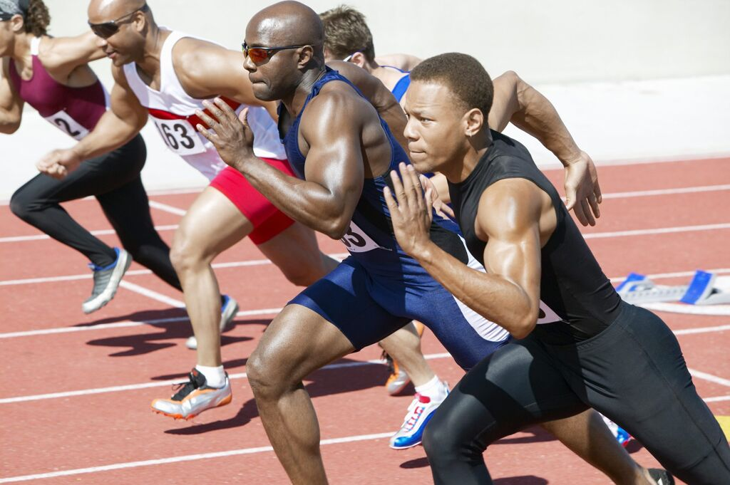 men sprinting on a track doing high intensity interval training